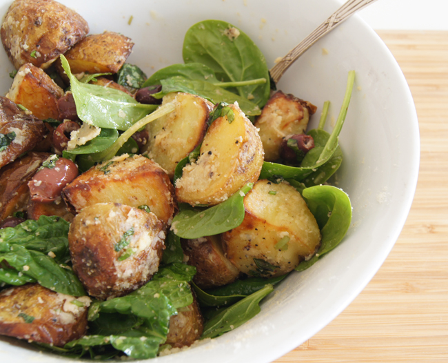 Parmesan-tossed potatoes with olives and spinach